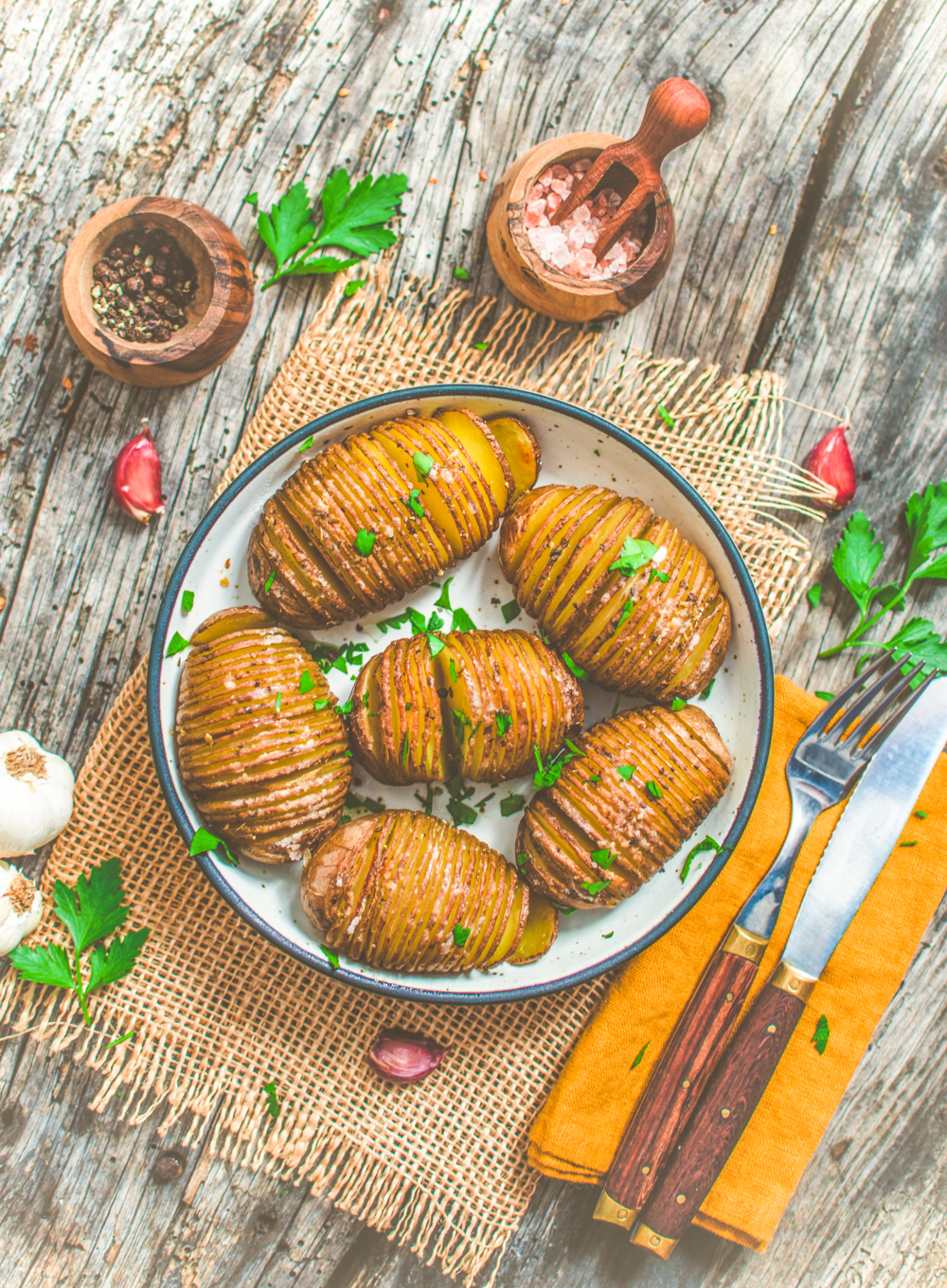 World of Vegan Hasselback Potatoes sprinkled with parsley
