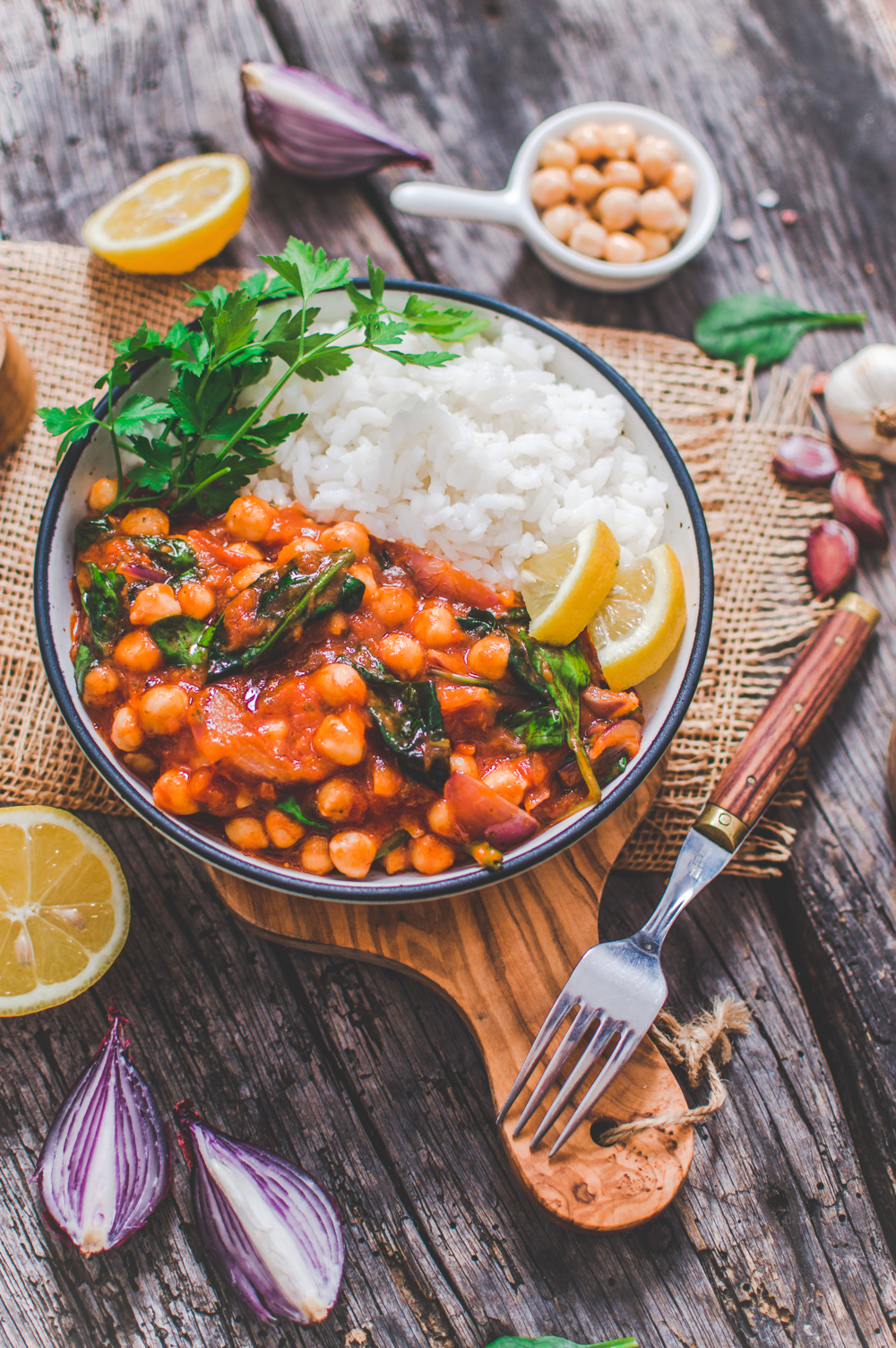 Vegan chickpea Stew Served on a Dish with Ingredients around