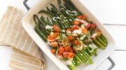 Sheet Pan Roasted Asparagus With Garlic, Tomatoes, and a Tahini Drizzle